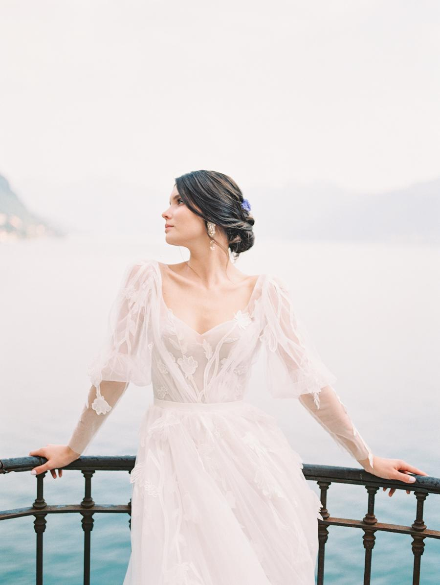 a romantic A-line wedding dress with floral lace, statement puff sleeves and a deep neckline is very chic