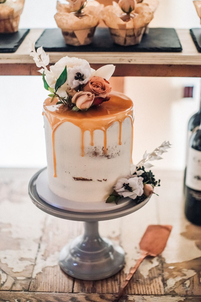 The wedding cake was a naked one, with caramel drip and fresh blooms on top
