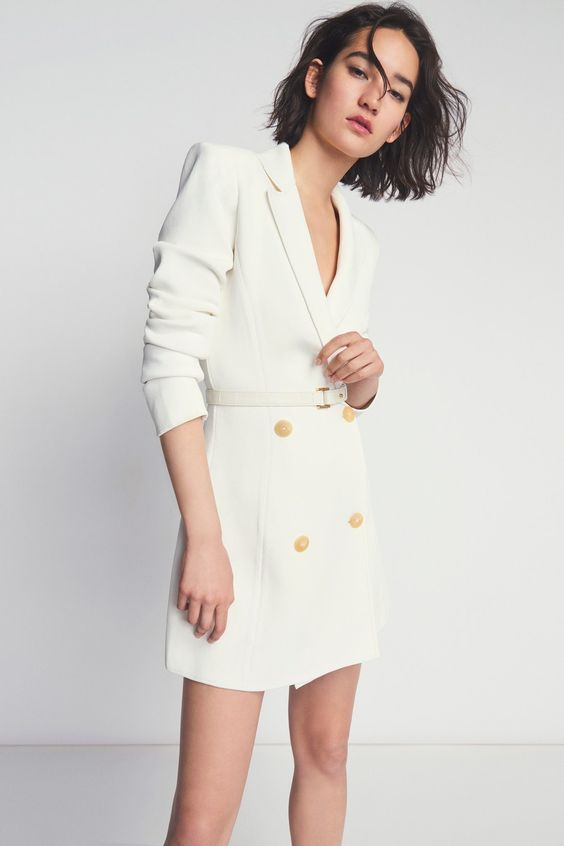 a white blazer as a mini wedding dress with gold buttons and a belt is a lovely idea for a city hall wedding