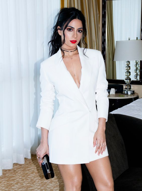 a minimalist white mini blazer dress, layered necklaces, a black clutch and a red lip for a sexy bridal look