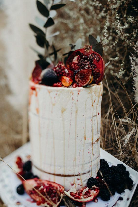 a naked fall wedding cake with drip, fresh figs and pomegranates is a lovely decadent idea for a fall celebration