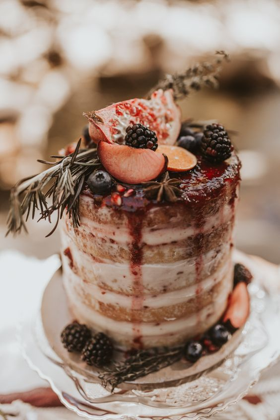 a naked wedding cake with berry drip, fresh fruits and berries is a gorgeous idea for a fall wedding