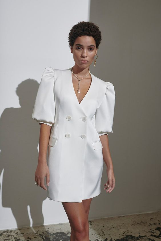 a pretty vintage-inspired white mini blazer dress with puff sleeves and faux pockets is a very stylish and edgy idea