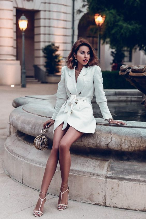 a little white tux dress with contrasting buttons, white strappy heels and statement earrings for a trendy look
