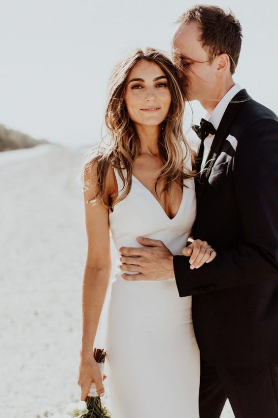 a minimalist sheath plain wedding dress with a deep neckline, no sleeves is a chic and stylish idea to rock