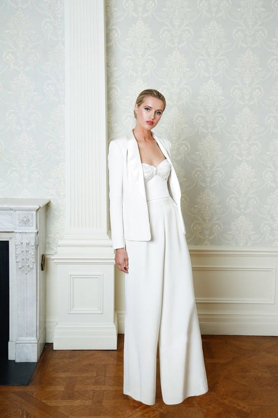 a bridal jumpsuit with wideleg pants and an oversized blazer as a coverup for a cold day