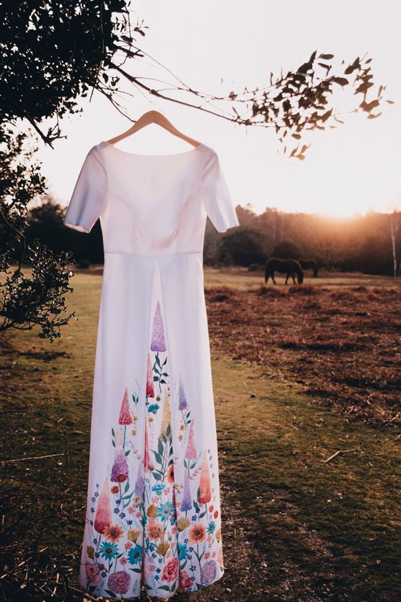 a plain A-line wedding dress with colorful floral and botanical prints is a very pretty and chic idea for a non-traditional bride