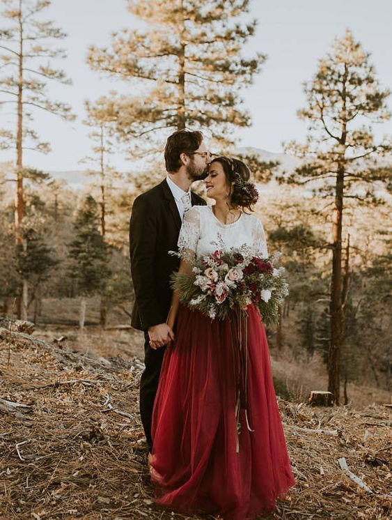 a chic bridal outfit with a white lace top and short sleeves plus a burgundy maxi skirt is a lovely idea for a fall wedding