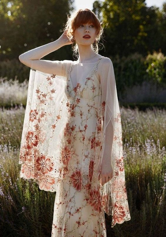 a refined wedding dress with a sheath wedding dress with colorful floral embroidery, embellishments and a coverup for a summer or fall bride