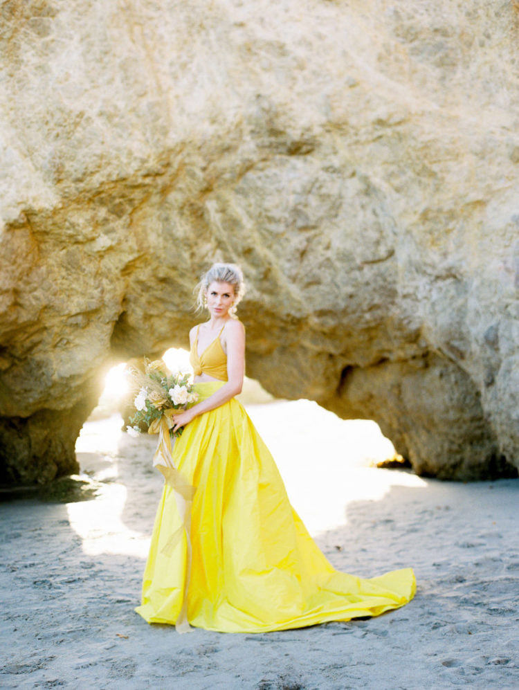 a mustard crop top and a sunny yellow full skirt with a train for a color-inspired and trendy bridal look