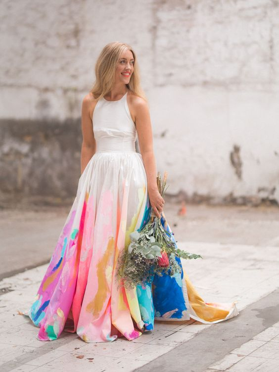 a bright strapless A-line wedding dress with a sleek bodice, a colorful skirt with brushstrokes and a train is jaw-dropping