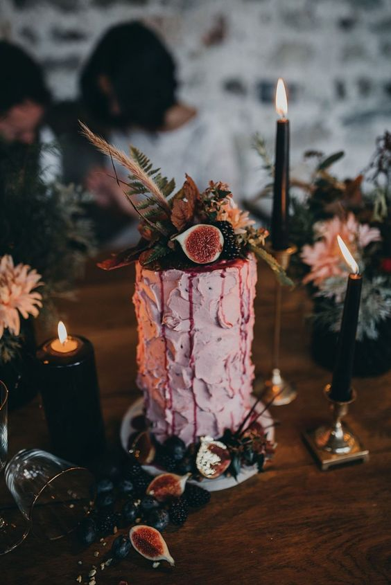 a small pink buttercream wedding cake with texture, fresh fruit and berries, grasses and fern looks amazing