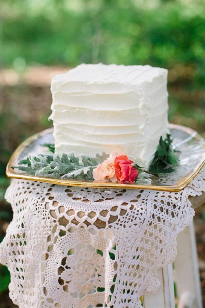 a small square wedding cake in white, with plenty of texture looks cool as less is more