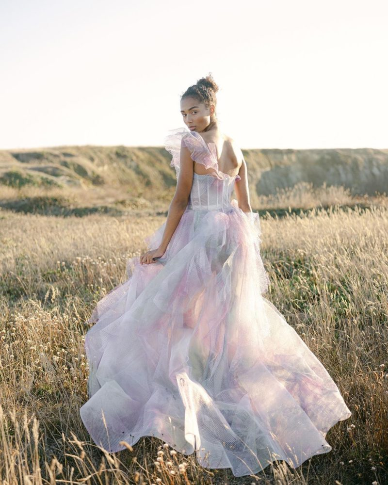 a pastel watercolor wedding ballgown with a corset bodice, a one shoulder strap and a train for a romantic spring wedding