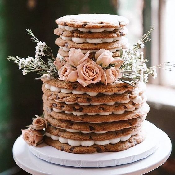 a small cookie wedding cake with blush roses and greenery is a pretty idea for a relaxed summer wedding