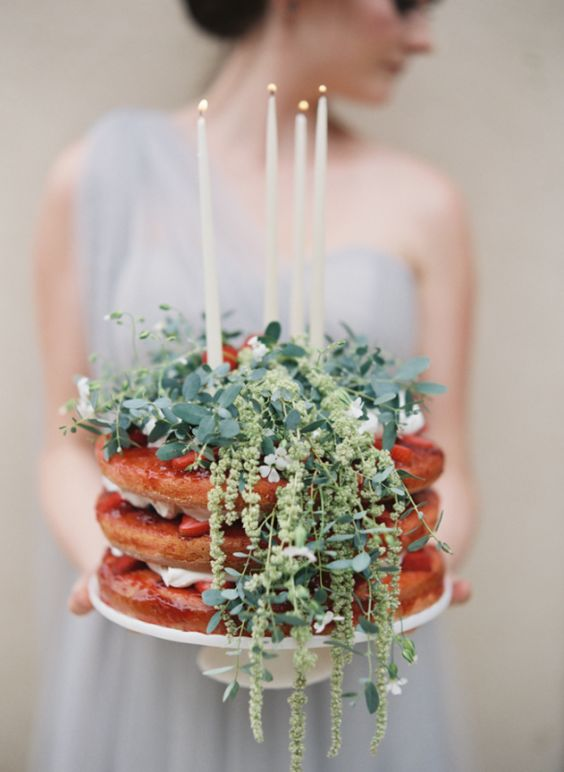 a waffle wedding cake with strawberries, fresh greenery and whipped cream plus candles is a great alternative for a traditional cake