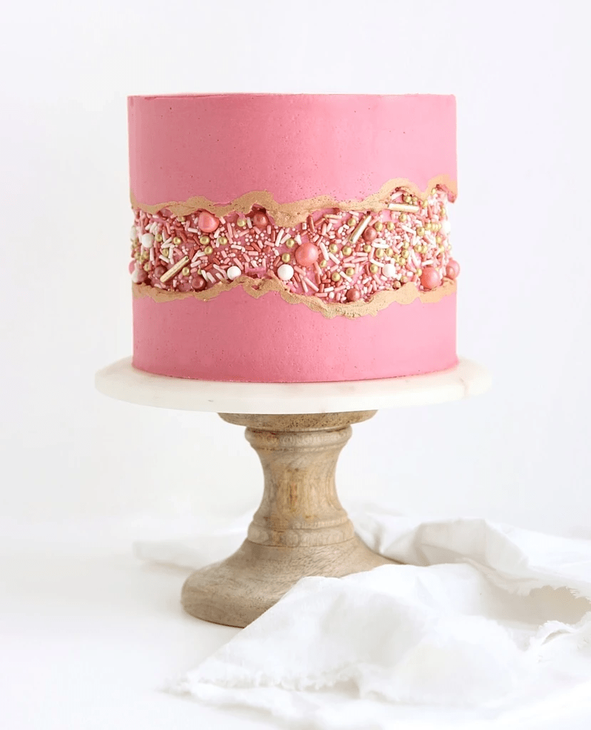 a stylish pink wedding cake