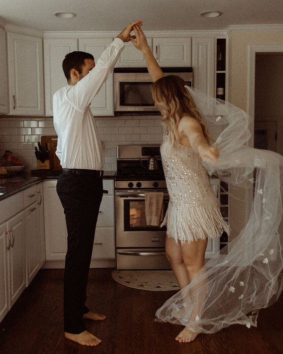 a pretty and romantic at home elopement with a small and intimate reception right in the kitchen