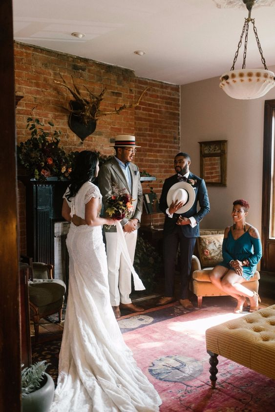 a wedding ceremony that took place right in the living room - just add rugs and lush florals to create a mood and an ambience