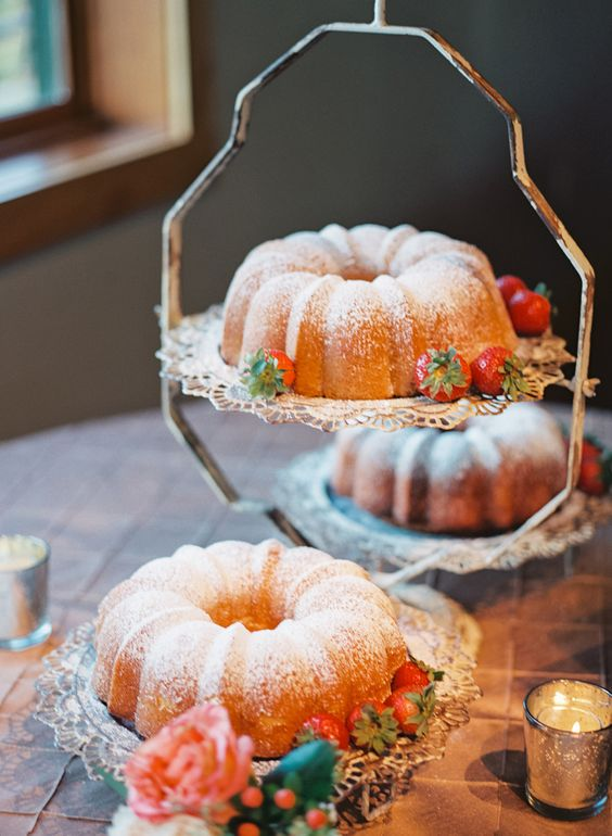 two bundt wedding cakes with sugar powder, strawberries are amazing for a laid-back wedding