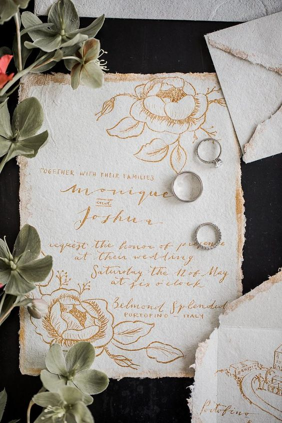 refined white and gold floral invitations with a raw edge and matching envelopes are chic and pretty