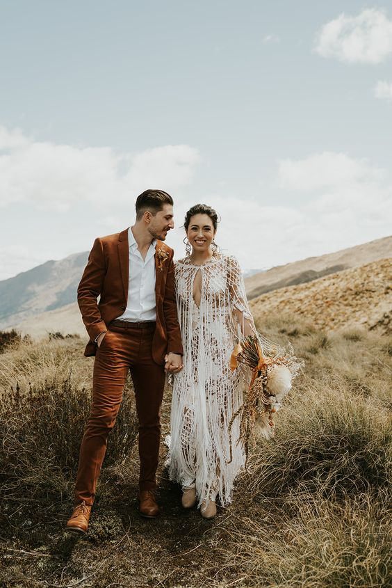 a boho groom's look with a rust-colored suit, a white shirt and brown shoes for a lovely boho wedding