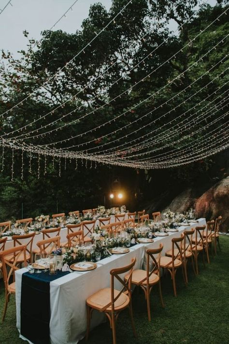 a beautiful outdoor wedding reception with a light canopy over it - the canopy isn't too large or intense but creates an ambience