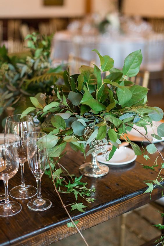 04 a beautiful wedding centerpiece of a silver bowl and an arrangement of lush textural greenery for a refined wedding