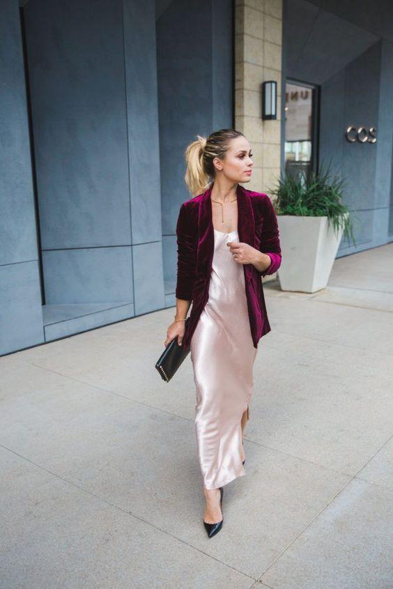 a blush slip maxi dress, a purple velvet blazer, black pumps and a black clutch plus a statement necklace