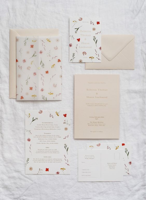 06 a pretty and bold floral wedding invitation suite with bright blooms and neutral envelopes is a chic idea