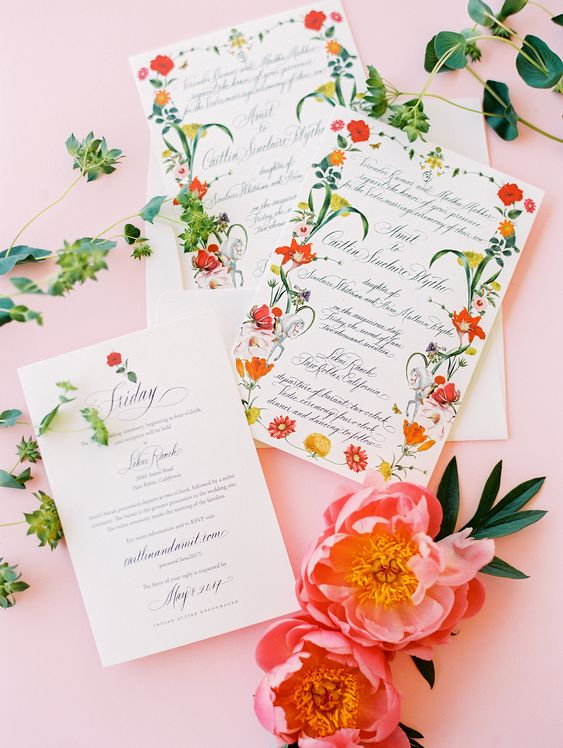 a pretty and bold floral wedding invitation suite with red and yellow bloom prints is a very bright and fun udea