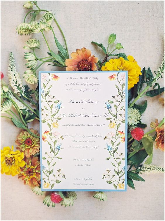 a pretty and bright floral invitation in yellow, orange and blue for an Italian wedding