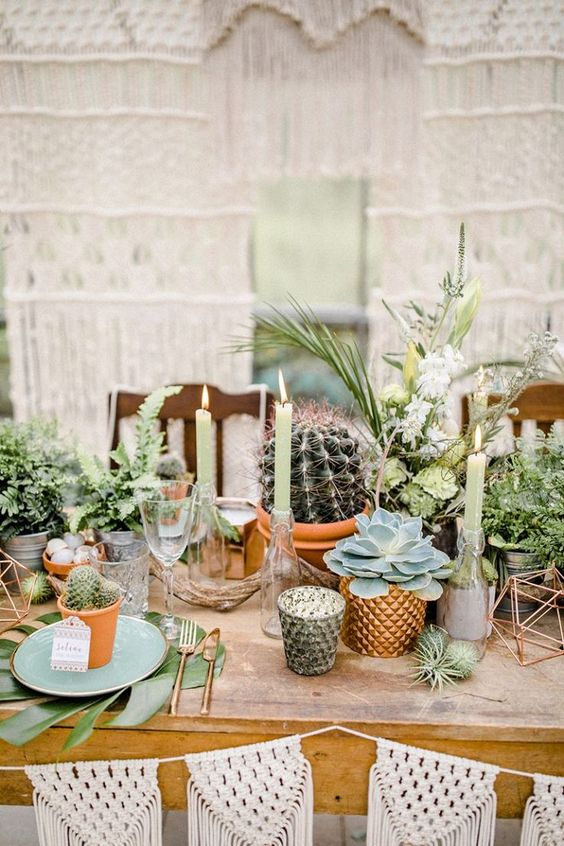 08 an urban jungle wedding centerpiece with greenery, cacti and succulents in pots plis air plants and green candles