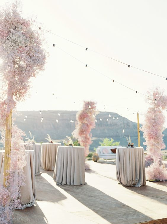 a cocktail space decorated with blush baby's breath clouds is a beautiful and romantic idea to rock