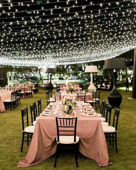 a cozy and welcoming outdoor wedding reception with a bright light canopy over it doesn't require any additional light