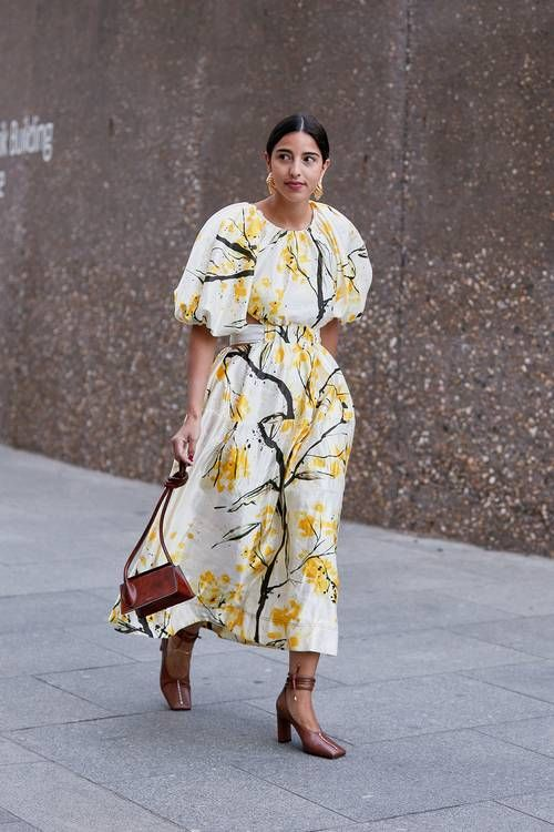 a white, black and yellow floral midi dress with statement sleeves, brown square toe shoes and a matching bag