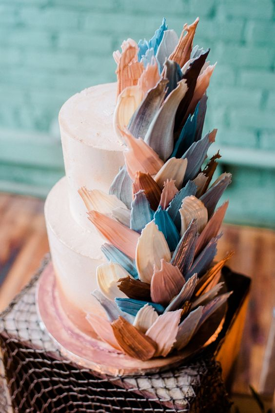 a beautiful wedding cake with pastel and colorful brushstrokes for an ocean wedding is a very pretty idea
