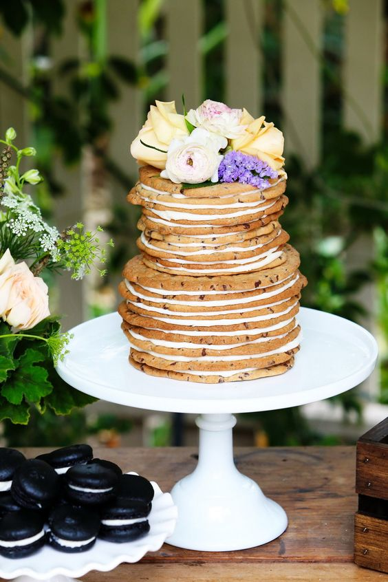 a cookie wedding cake with fresh blooms on top is a lovely idea for a relaxed woodland or backyard wedding