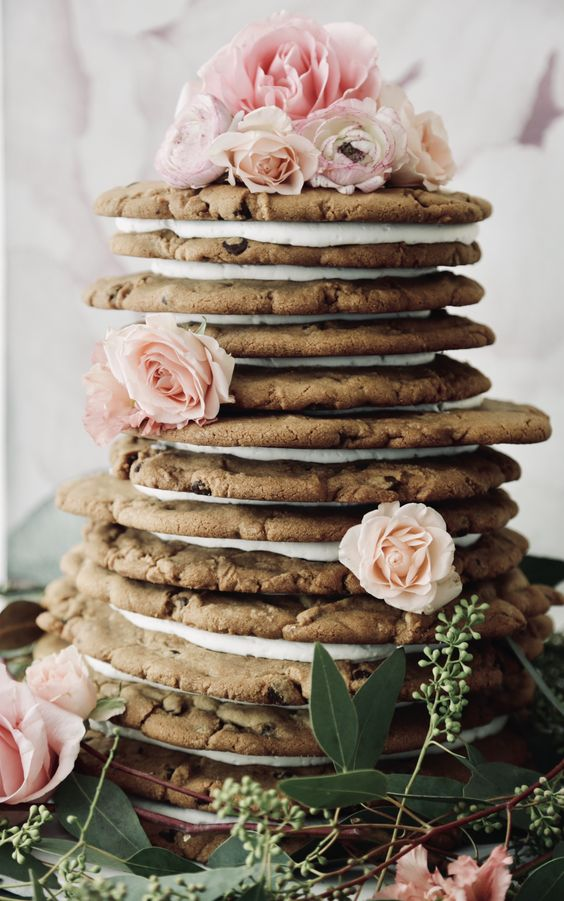a cookie wedding cake with fresh pink roses and greenery is a lovely idea for a relaxed spring or summer wedding