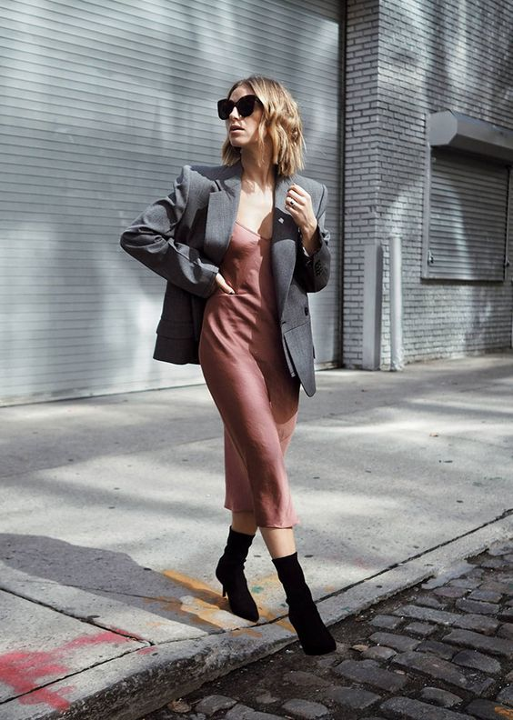 a mauve slip midi dress, a grey oversized blazer, black sock boots for a relaxed and minimal guest outfit