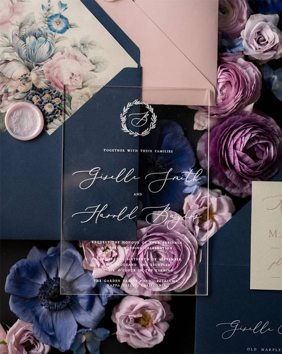 a refined navy and blush wedding invitation suite with floral lining and acrylic touches is a very chic idea