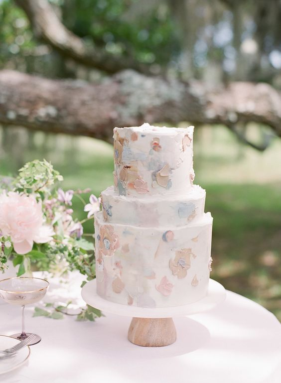 a beautiful pastel brushstroke floral wedding cake is a very tender and romantic piece for a spring or summer wedding