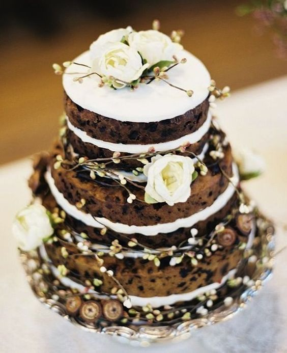 a cookie wedding cake with white frosting and fresh white and usual blooms is a pretty idea for a fall wedding