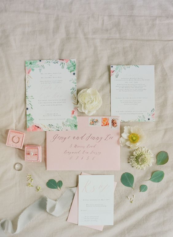 a romantic and tender pastel floral and botanical wedding invitation suite with pink envelopes is a chic idea