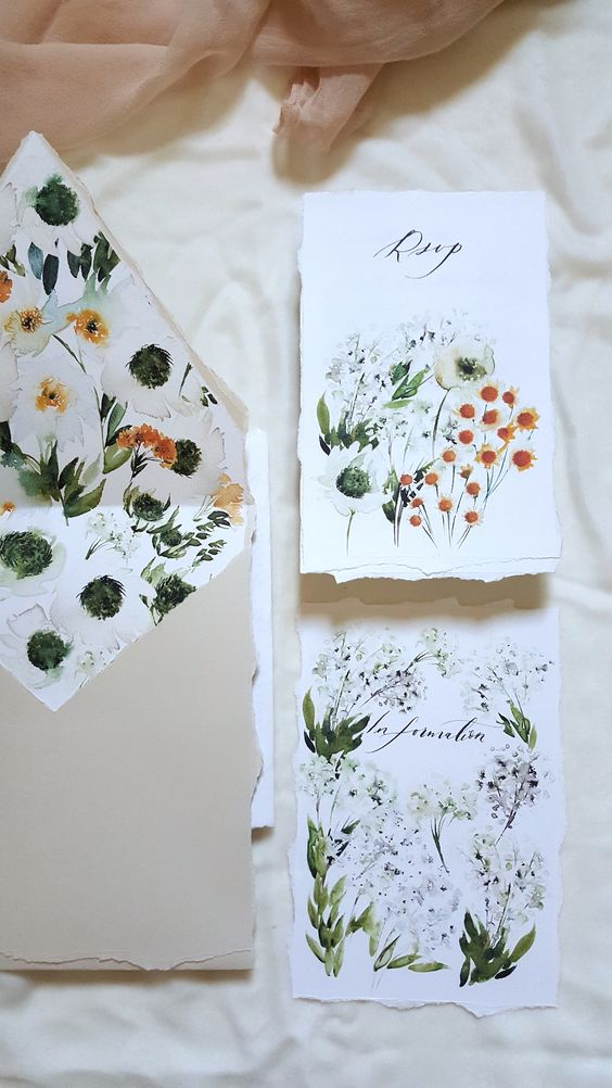 a romantic wedding invitation suite with realistic painted blooms is a very chic and beautiful idea