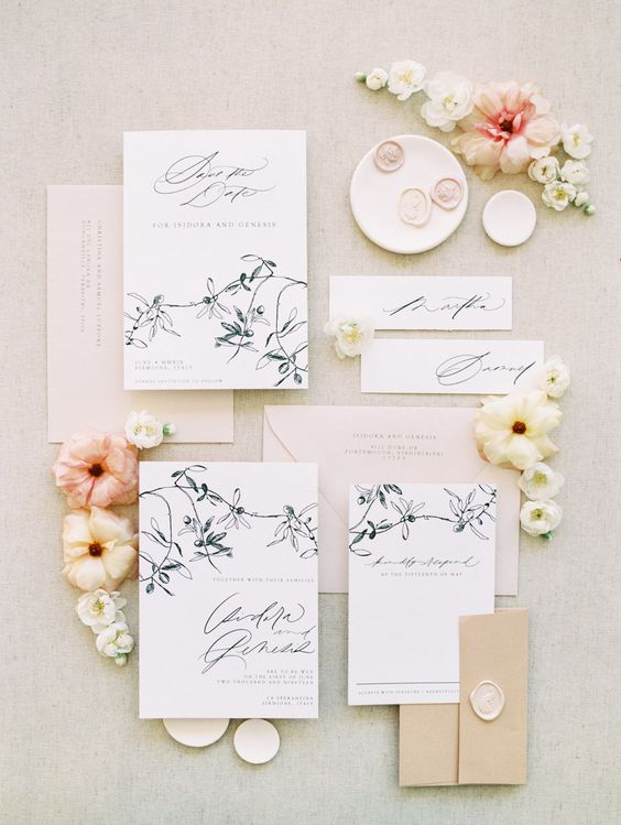 a stylish floral wedding invitation suite with pastel envelopes and black floral prints is a very elegant idea for a neutral wedding