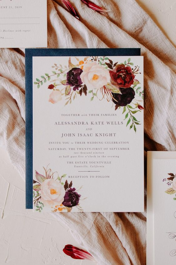 a beautiful fall wedding invitation with bold blooms painted and a blue envelope is a beautiful and refined idea