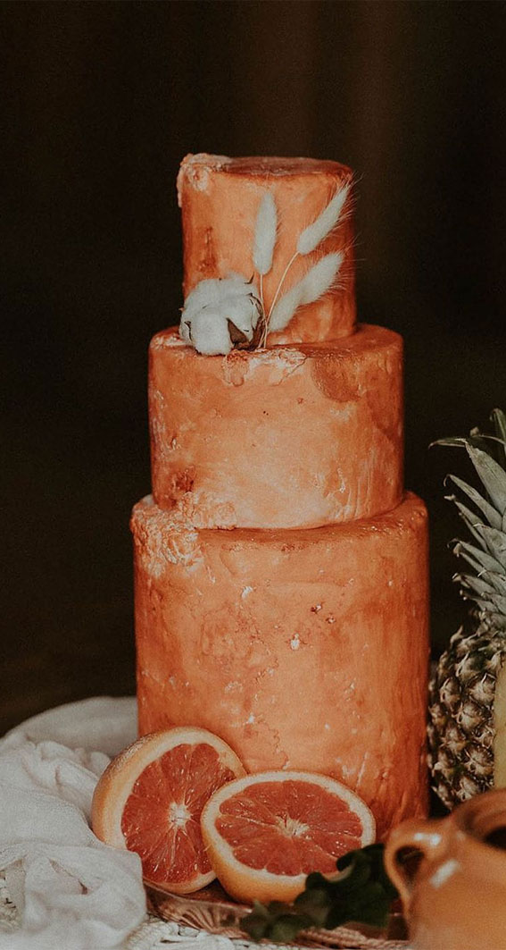 a terracotta wedding cake with plenty of texture, with cotton and grasses is a chic idea for many weddings with a boho feel