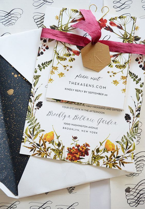 a beautiful floral print wedding invitation suite with bold bloom prints and a bright ribbon is a stylish idea to rock