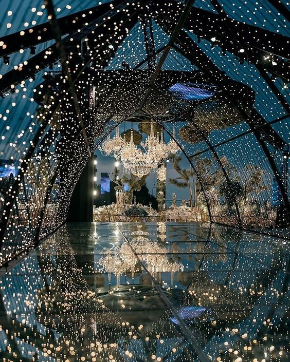 a luxurious light canopy over a glass floor leading to the reception makes it even more magical and gorgeous